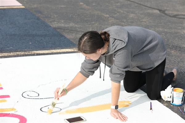 Marion Seniors Paint Their Own Parking Spots