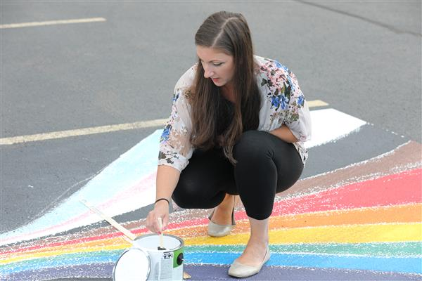 Mrs. Reynolds paints a parking spot in support of the Class of 2021.