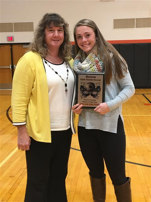 Coach DeLyser with Wayne County Player of the Year, Chloe DeLyser