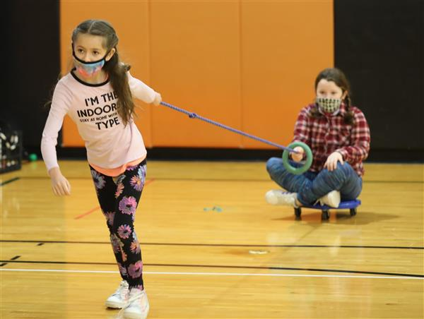 Students participate in scooter relay